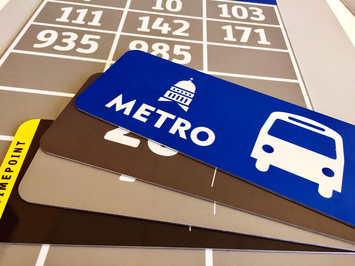 samples of Cap Metro bus stop signage