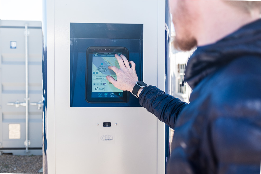 person using the Interactive Kiosk interface on the SmartStop's 10-inch touch screen